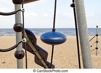 Kid playground near sea. Climbing equipment