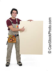 craftsman holding an empty poster