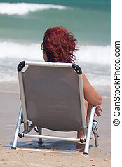 person sitting - woman sitting by the sea