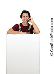 Carpenter on the phone by blank bill board