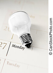 light bulb on calendar, concept of everyday innovation