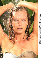 woman in tropical shower palms around - woman in tropical...
