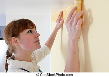 Woman redecorating her home