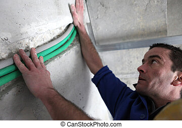 Electrician installing cables