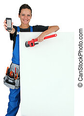 Female plumber with tools