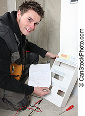 Electrician with a fuse box