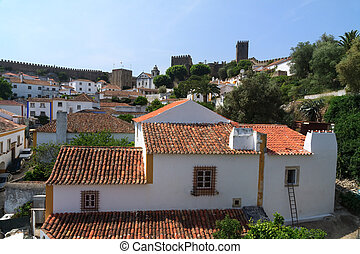Tile roofs of houses in Obidos, Portugal