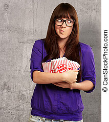 Girl Holding Empty Popcorn Packet, Indoor