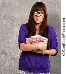 Girl Holding Empty Popcorn Packet, Indoor