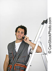 Man with a phone and stepladder
