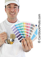 Smiling painter showing swatches