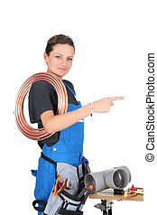 Female plumber with equipment
