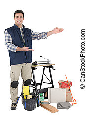 Proud tradesman showing off his tools
