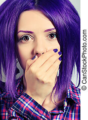 scared - Portrait of a punk girl with purple hair.