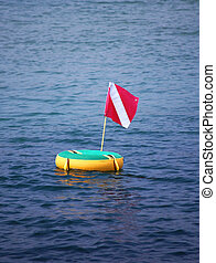 scuba flag on floater in bay