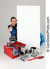 Joyful female laborer with panel and toolbox