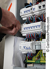 Worker repairing a distribution board