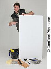 Tiler pointing advertising panel