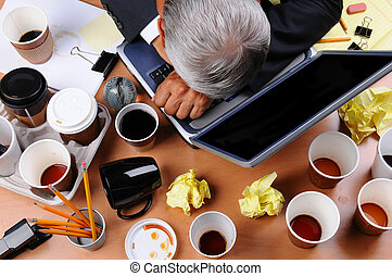 Cluttered Businessmans Desk - Closeup view of a very...