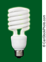 Glowing compact fluorescent light bulb on green