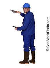 Worker with a trowel