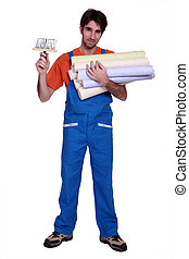 Decorator with rolls of wallpaper