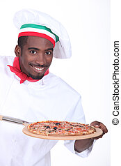 Chef with pizza on a wooden peel