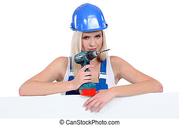 Sexy construction worker holding an electric screwdriver