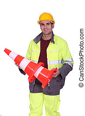 Highway worker with traffic cones