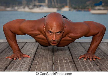 strong man doing press ups - fit healthy strong man doing...