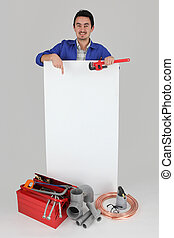 Man pointing at blank board with toolbox