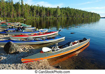 Colorful canoes on a sand bank , Karelia - Colorful canoes...