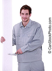 Man holding a trowel and decorative crown molding
