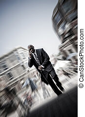 Modern Mobile Business Man - A confident business man...