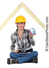 Woman sitting on a slatted roof