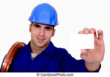 Plumber holding business card