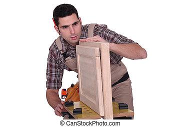 Cabinetmaker leveling cabinet doors