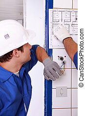 electrician watching plan