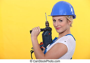 blonde woman holding a power drill