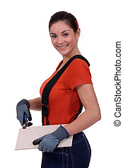 Tradeswoman holding a tile