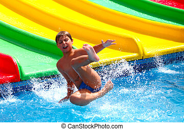 Child on water slide at aquapark