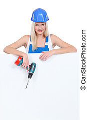 Young woman with drill on white background