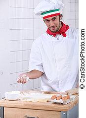 pizzaiolo preparing pizza