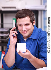 Plumber ordering new parts over the telephone