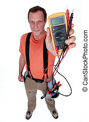 Electrician holding a voltmeter