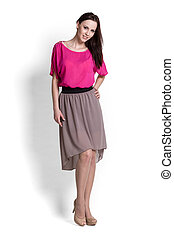 Beautifull woman in pink blouse and beige skirt