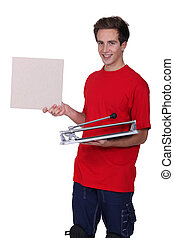 Man stood with tile cutter