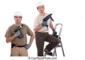 Workmen holding their electric screwdrivers