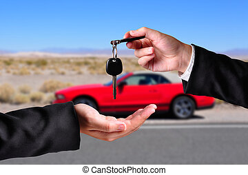 Handing over the keys - A hand giving a key to another hand....