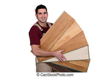 Man displaying variety of laminate flooring